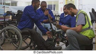Workers with disabled man working - Side view of a group of ...