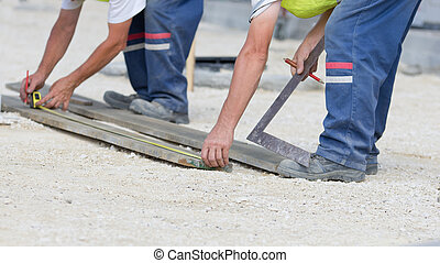 Workers with measuring tape