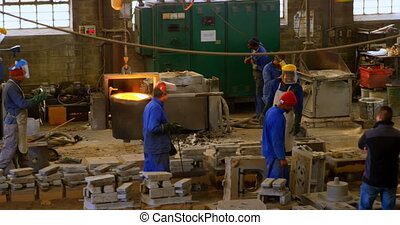 Workers working in foundry workshop 4k - Workers working in ...