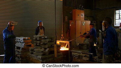 Workers working in foundry workshop 4k