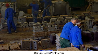 Workers working together in workshop 4k
