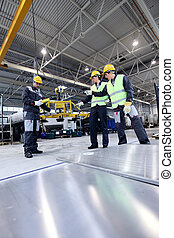 Workers working with aluminium billets