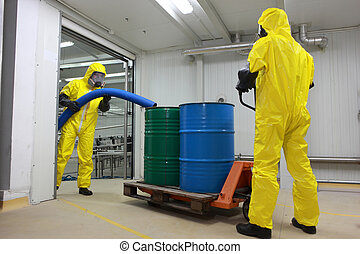 Two professionals working with toxic waste in factory