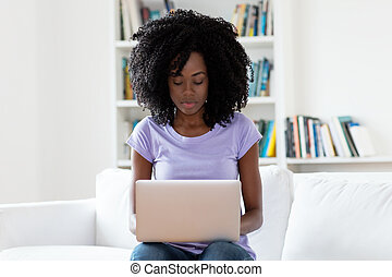 Working african american woman with computer