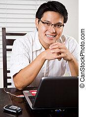 Working asian entrepreneur - An asian entrepreneur working...