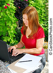 Working at home - Woman working on her computer at home,...