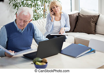 Working at home - Elderly marriage working at their home