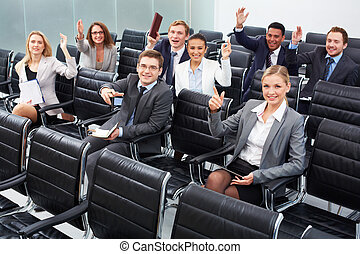 Working at seminar - Image of business people sitting in...