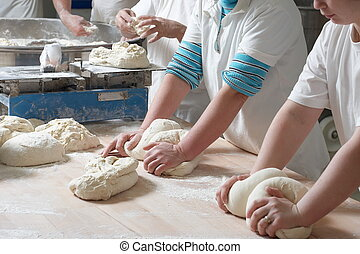 Working bakery team - Women bakery team at work weigh and...