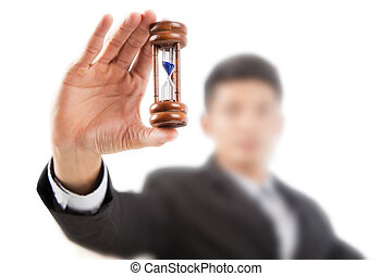 Working businessman hold a hourglass timer