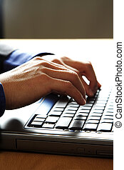 Working businessman - Businessman working and typing on his...