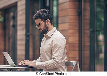 Working businessman with laptop