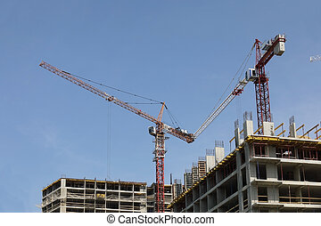 Working construction crane on a background of clear blue sky