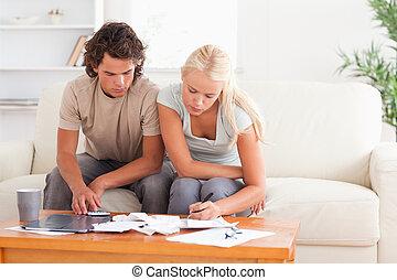 Working couple sitting