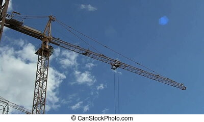 Working crane at construction site in summer