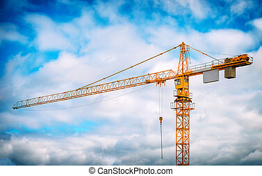 Working crane in the sky. Construction site.