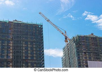 Working crane in the sky