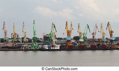 working cranes at port