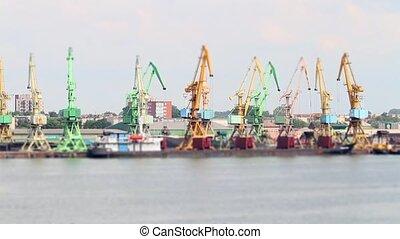 working cranes at port, tilt-shift