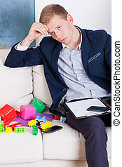 Working dad among child's toys - View of working dad among ...