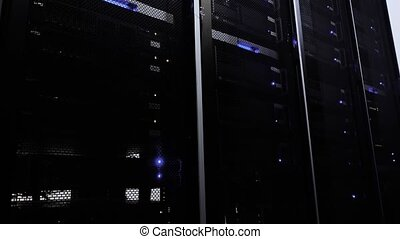 Working Data Center With Rows of Rack Servers. Blue light. Dark server room.