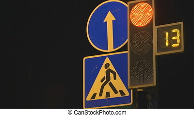Working digital traffic light in night-time