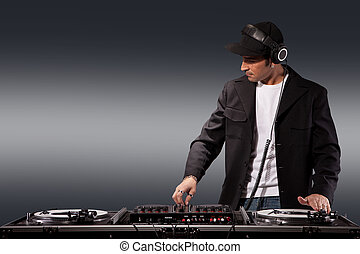 Working DJ - Photo of adult dj working with his equipment