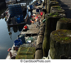 Working dock - A working lobster boat along the dock in ...