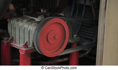 Working electric motor on a factory machine. - Working...