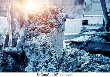 Working excavator, blue tone image.
