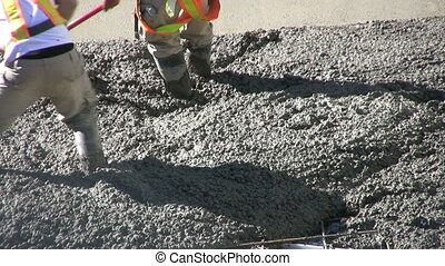 Working Fresh Cement - Several construction workers use...