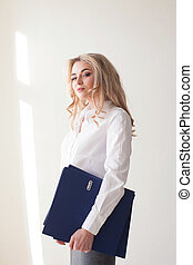 Working girl blonde with blue folders