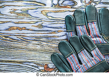 Working gloves on wooden board