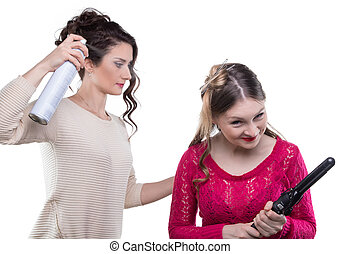 Working hairstylist with hairspray
