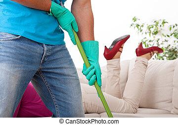 Working husband - Husband working in house while his wife...