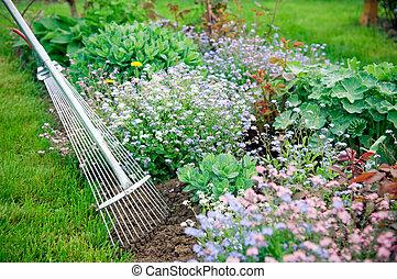 Detail of gardening with fane rake
