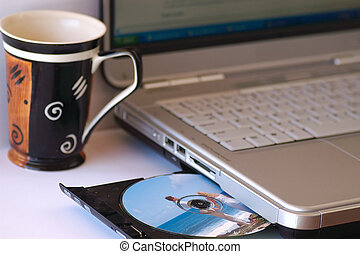 working in morning - Having coffee while working on laptop.