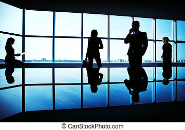 Working in office - Silhouettes of several office workers ...