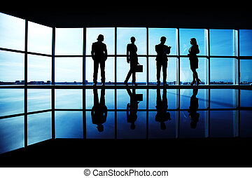 Working in team - Silhouettes of several office workers ...