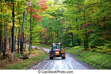 Working In The Forest - Cutting and leveling grass by the...