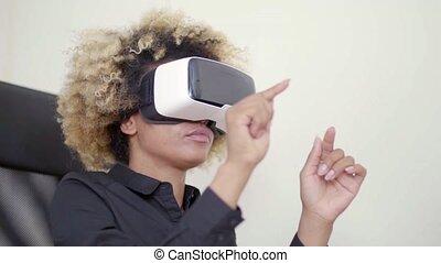 Working In Virtual Reality - A woman working in virtual...