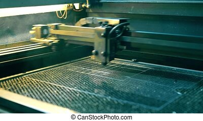 Working lazer graving device video in production plant