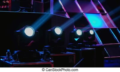 Working lighting equipment at the event on a stage