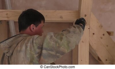 Working man causes the glue on the wooden staircase