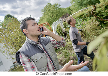 Working man outdoors on telephone