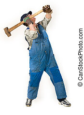 working man - portrait of workman with sledge hammer over...