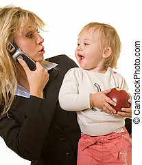 Working mom with baby - Attractive blond woman in business...