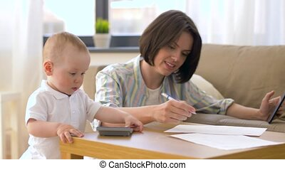 working mother and baby playing with calculator -...