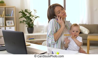 working mother with baby calling on smartphone -...
