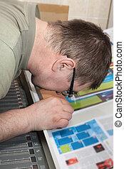 working offset printer - Printer checking a print run at...